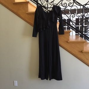 Cosics jumpsuit sz M ruffled chest black NWT